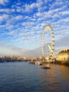 london eye on river thames with nice clouds