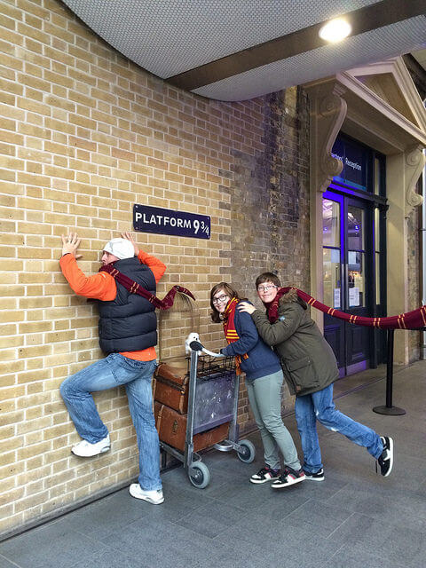 Harry Potter Platform 9 3/4 at Kings Cross station with teens