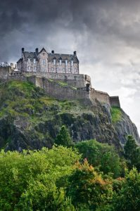 Winter in Edinburgh. Edinburgh castle over dramatic clouds, Scotland, UK